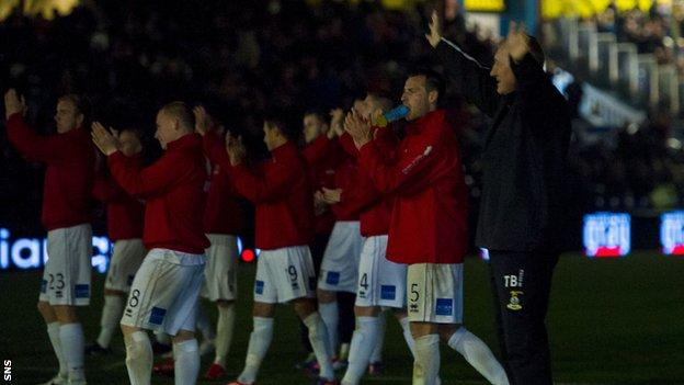Inverness boss Terry Butcher and his players salute the fans