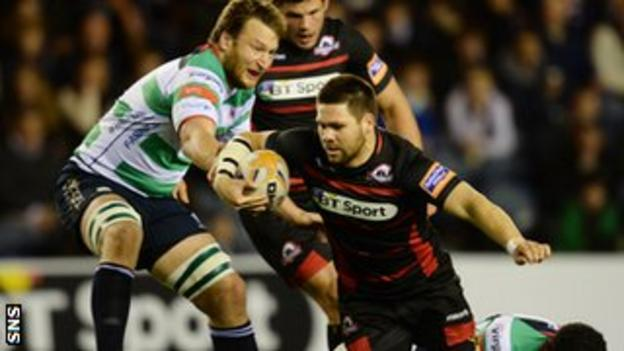 Edinburgh flanker Cornell Du Preez is thwarted by the Marco Fuser