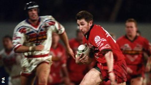 Jonathan Davies launches an attack for Wales against England