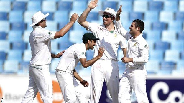 South Africa celebrate the wicket of Misbah-ul-Haq in Dubai