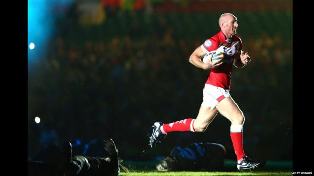 Former Wales rugby union captain and rugby league convert Gareth Thomas makes an appearance at the World Cup opening ceremony