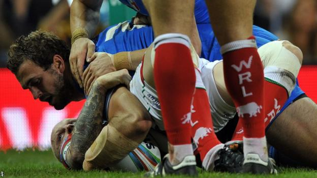 Joshua Mantellato scores a try for Italy, who dominate the second half at the Millennium Stadium to beat Wales 32-16