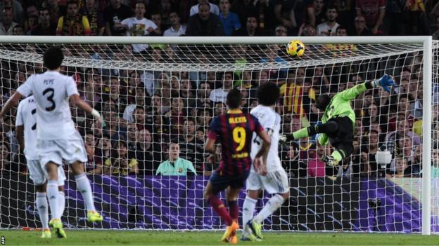 Barcelona winger Alexis Sanchez scores against Real Madrid