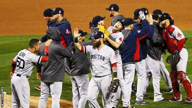 Boston Red Sox players celebrate victory over the St Louis Cardinals