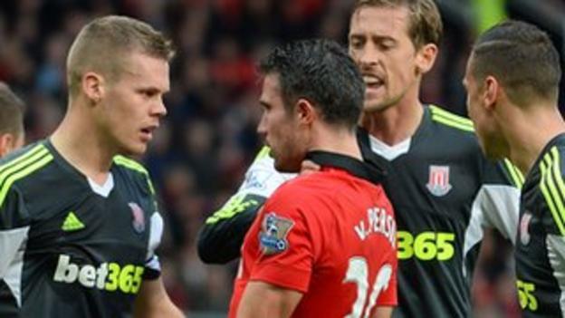 Manchester United striker Robin van Persie argues with Stoke defender Ryan Shawcross