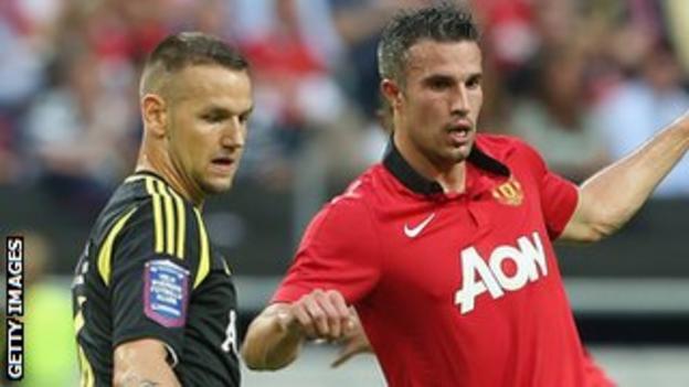 Alexander Milosevic (left) in action for AIK against Manchester United