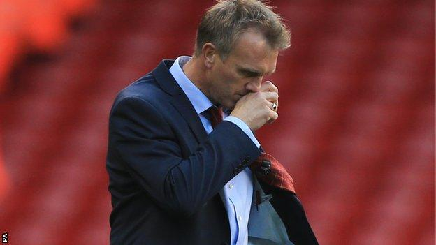 Crewe Alexandra manager Steve Davis shows his dejection after 3-1 defeat against Sheffield United
