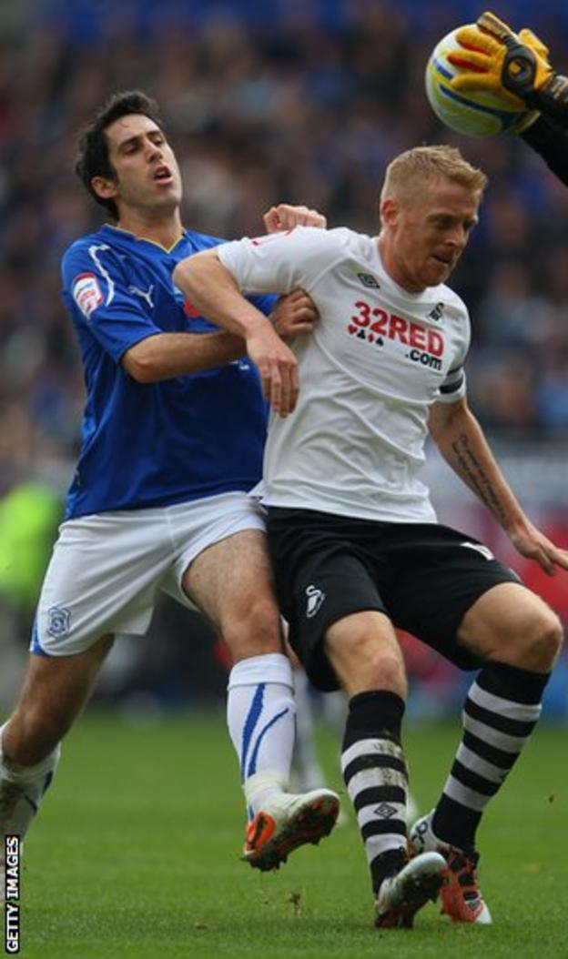 Cardiff's Peter Whittingham battles with Swansea defender Garry Monk in 2011