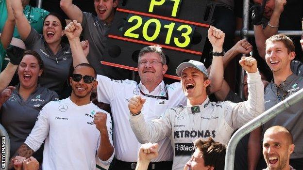 Lewis Hamilton, Ross Brawn and Nico Rosberg