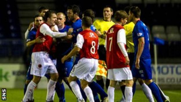 The Inverness and United players become embroiled in a brawl