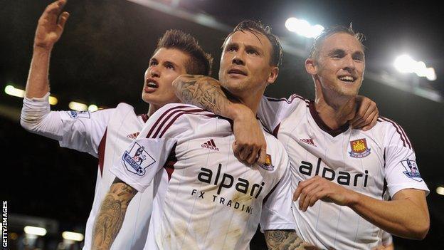 West Ham celebrate Matt Taylor's opening goal at Burnley