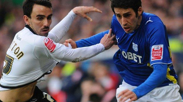 Leon Britton and Peter Whittingham tangle during the last match between Cardiff and Swansea