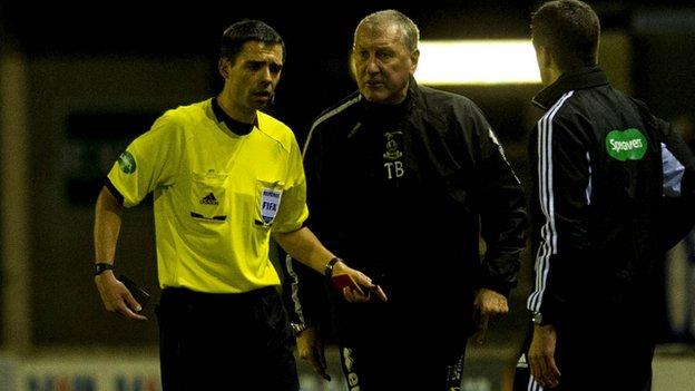 Referee Kevin Clancy and Inverness manager Terry Butcher