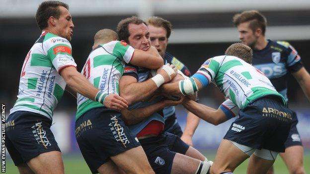 Cardiff Blues forward Lou Reed is stopped by the Treviso defence