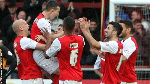Steve Schumacher celebrates with his team-mates