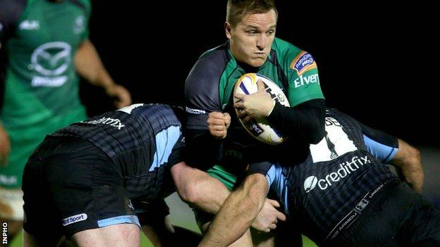 Connacht pair Paul O'Donohoe and Jon Welsh tackle Glasgow's Gordon Reid
