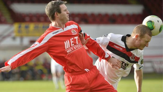Portadown skipper Kevin Braniff in action against David Magowan in the match at Shamrock Park which the Crues won 1-0
