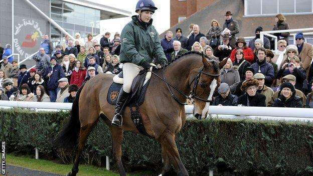 Kauto Star and Laura Collett in the parade ring at Newbury