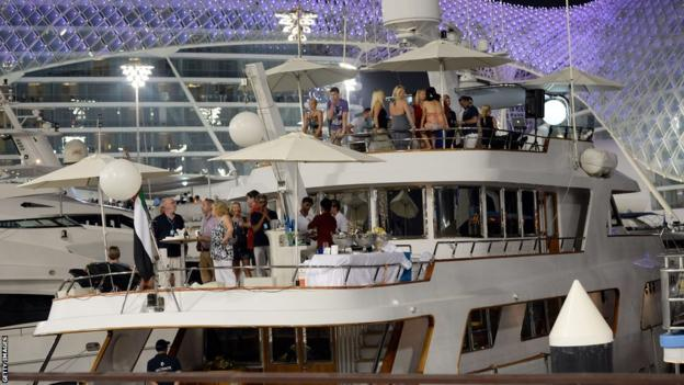 Spectators party on a yacht during the second practice session at the Abu Dhabi Grand Prix