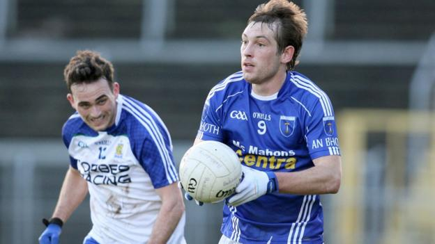 A determined Dermot McGuckin attempts to close down Scotstown's James Turley