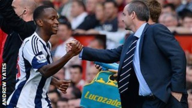 Berahino celebrates with Baggies boss Steve Clarke