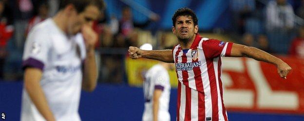 Atletico Madrid's Diego Costa celebrates his side's fourth goal in the 4-0 win over Austria Vienna