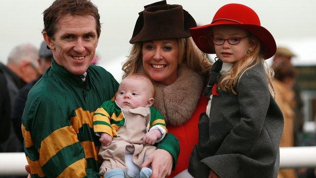 AP McCoy celebrates his 4,000th career win with daughter Eve, son Archie Peter and wife Chanelle at Towcester