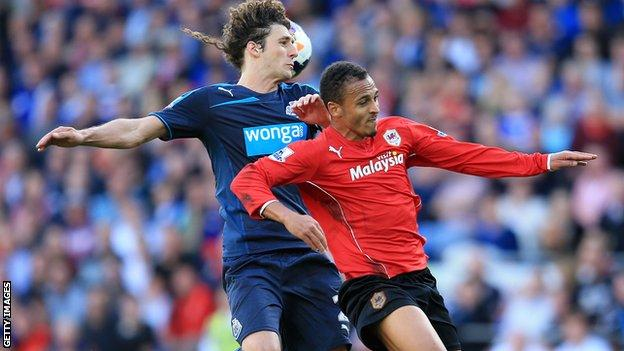 Newcastle defender Fabricio Coloccini (left) battles with Peter Odemwingie of Cardiff