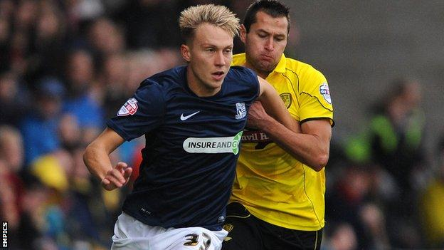 Cauley Woodrow in action against Burton Albion