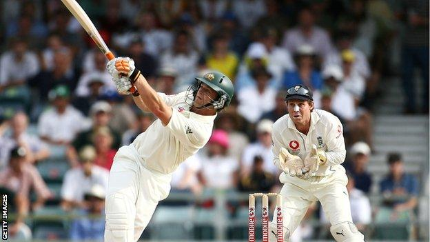 Adam Gilchrist hits out, watched by England keeper Geraint Jones