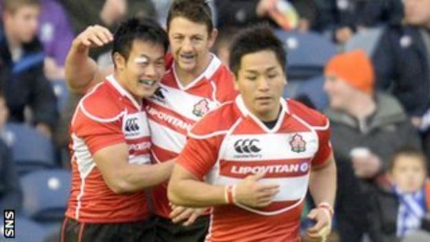 Japan's Kenki Fukuoka (left) twice brought his team back into the match