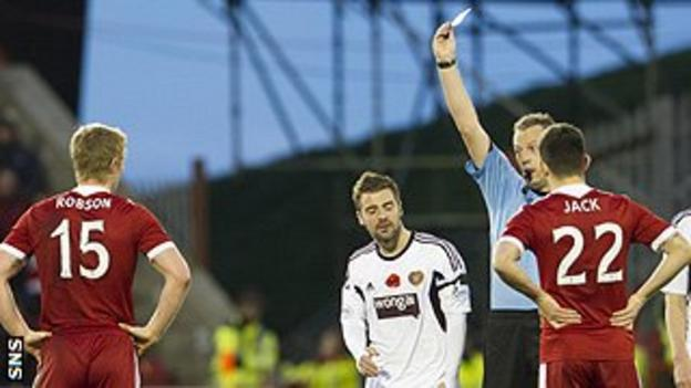 Aberdeen sub Barry Robson is shown a second yellow card, with a red to follow