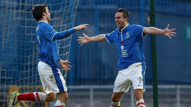 Philip Lowry congratulates goal-scorer Andy Waterworth during Linfield's convincing 5-1 win over Warrenpoint Town