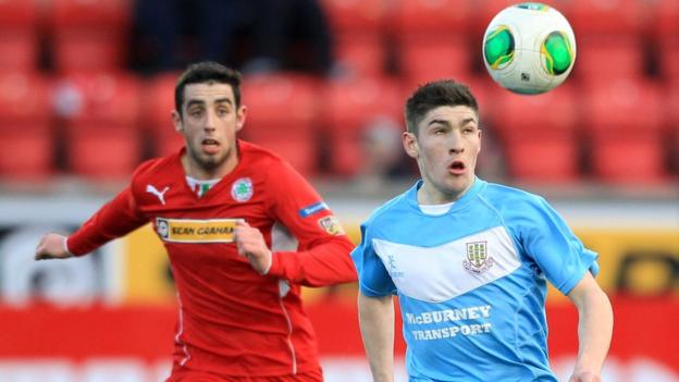 Cliftonville's Joe Gormley and Ballymena's Michael Ruddy keep their eyes on the ball