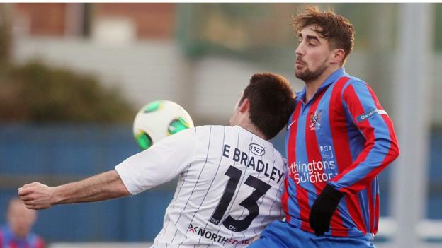 Eoin Bradley and David Gibson battle for possession during Coleraine's game with Ards