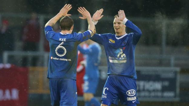 David Kee and Cathal Beacom enjoy their side's victory over Portadown at Ferney Park
