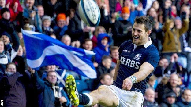 Tommy Seymour celebrates his first try