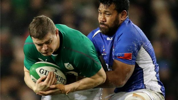 Brian O'Driscoll is challenged by Ofisa Treviranus as Ireland get Joe Schmidt's reign as coach off to a winning start