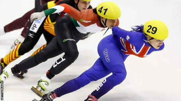 Elise Christie (right) in action the quarter-finals of Britain's short-track skating Olympic qualifier