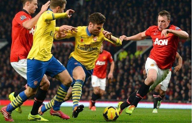 Phil Jones (r) worked tirelessly to keep Arsenal quiet
