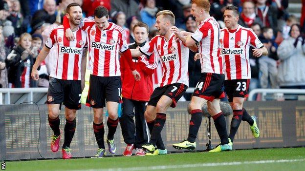 Phil Bardsley (far left) celebrates with teammates after putting Sunderland ahead against Man City