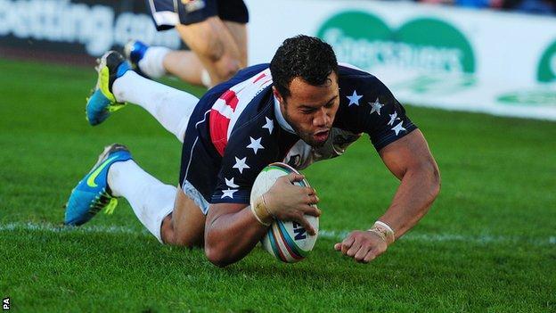 USA captain Joseph Paulo scores a try