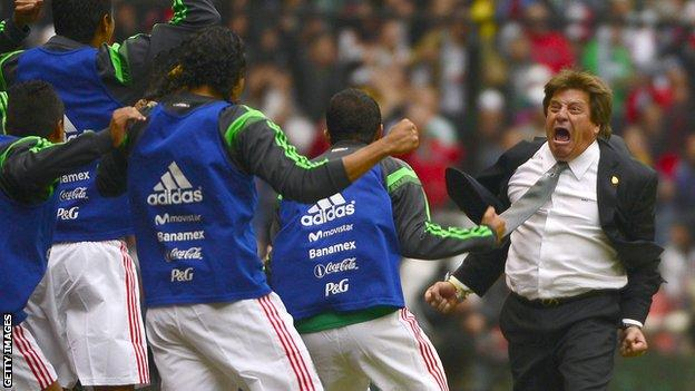 Mexico coach Miguel Herrera celebrates with his players after a goal against New Zealand