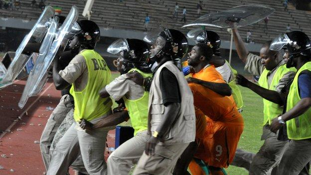 Ivorians take refuge during the riot that affected last year's Nations Cup qualifier in Senegal.