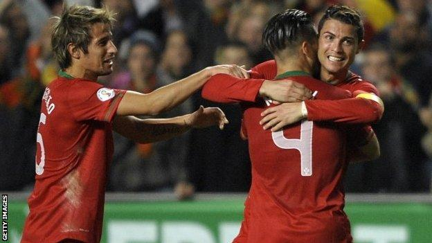 Portugal forward Cristiano Ronaldo (right) celebrates with team-mates after scoring a goal during the World Cup qualifier play-off first leg football match vSweden