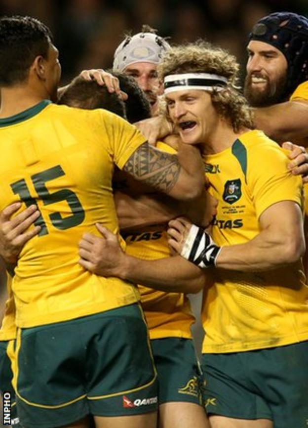 Australian celebrates after Quade Cooper scored their third try against Ireland