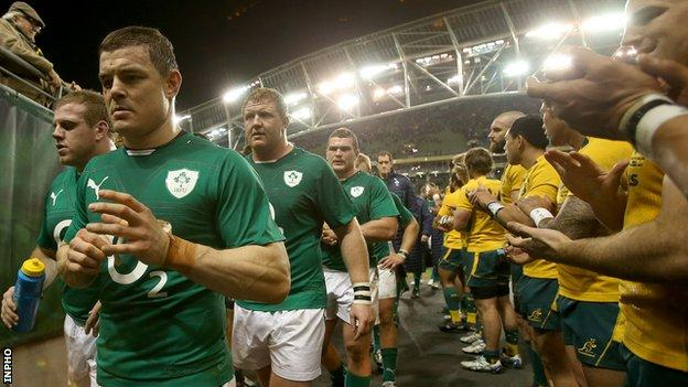 Brian O'Driscoll troops off with dejected Ireland team-mates after the 32-15 defeat by Australia
