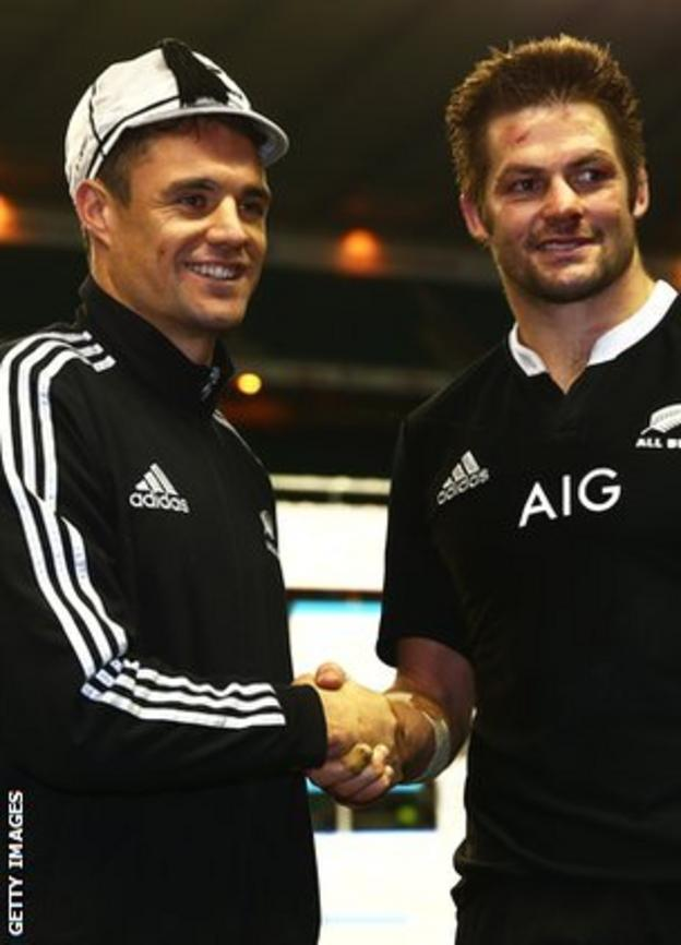 Fly-half Dan Carter receives his 100th cap from captain Richie McCaw