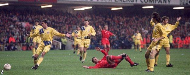 Gary Speed is sent tumbling in the Romania box