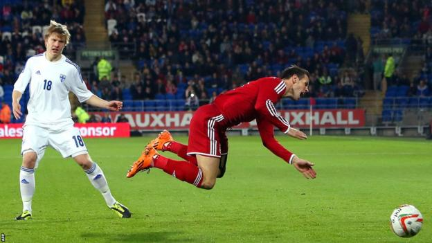 Wales forward Gareth Bale is sent flying by Jer Uronen of Finland in the friendly at Cardiff City Stadium